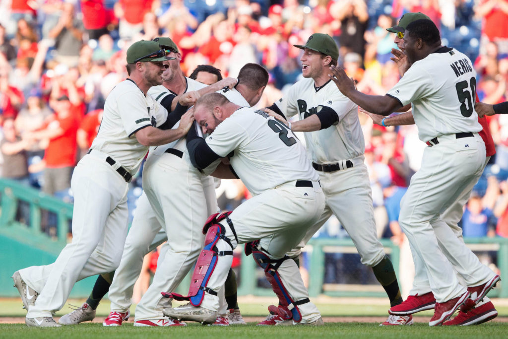 Tommy Joseph celebrates with teammates after a walk off hit against the Reds.