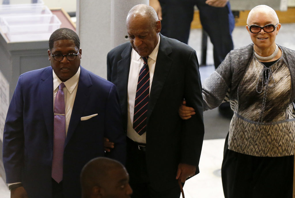 Andrew Wyatt, left, Bill Cosby, center, and his wife, Camille Cosby, right, enter the Montgomery County Courthouse in Norristown, PA on June 12, 2017.