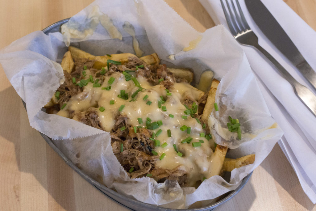 Duck confit fries (served with a cloth napkin) are a Blue Duck bestseller
