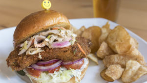 Fried chicken sandwich with housemade potato chips at Flying Fish Crafthouse