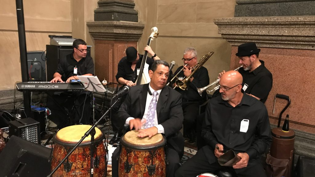 Siempre Salsa Philly co-founder Carlos Sanchez (center) playing with Un Toque de Cache in City Hall.