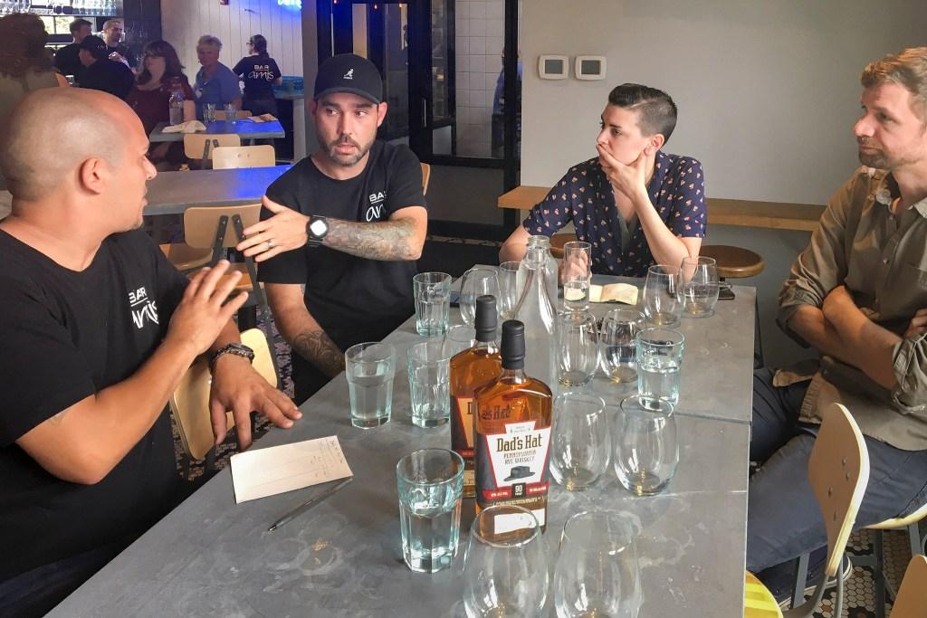 Bartender Anwar Morgan, chef de cuisine Jared Frazer, Bar Amis beverage director Jordan Stalsworth and Vetri Family beverage director Steve Wildy discuss details for the dinner