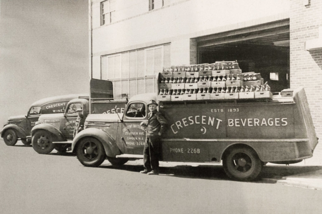 Ernest Holscher outside Crescent Bottling Co., which is in the same location today