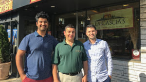 Jobletics founder and president Rahul Sharma (far left) with the owner of La Casias Bakery (a Jobletics partner) and co-founder Jad Chahine
