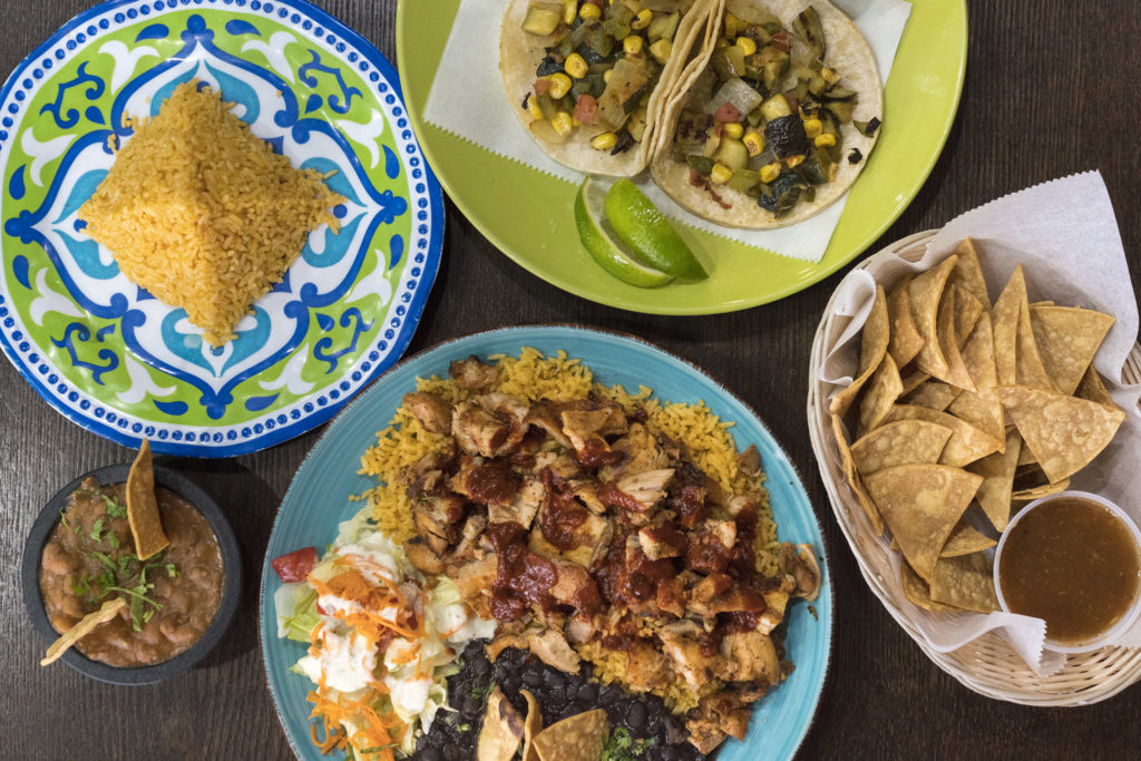 Calabacitas tacos, chips and salsa, grilled chicken platter and beans and rice at Nora's