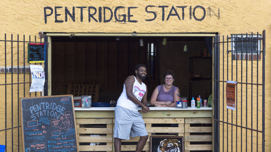 Ephream Amare Seyoum (left) and a staffer at Pentridge Station's main bar
