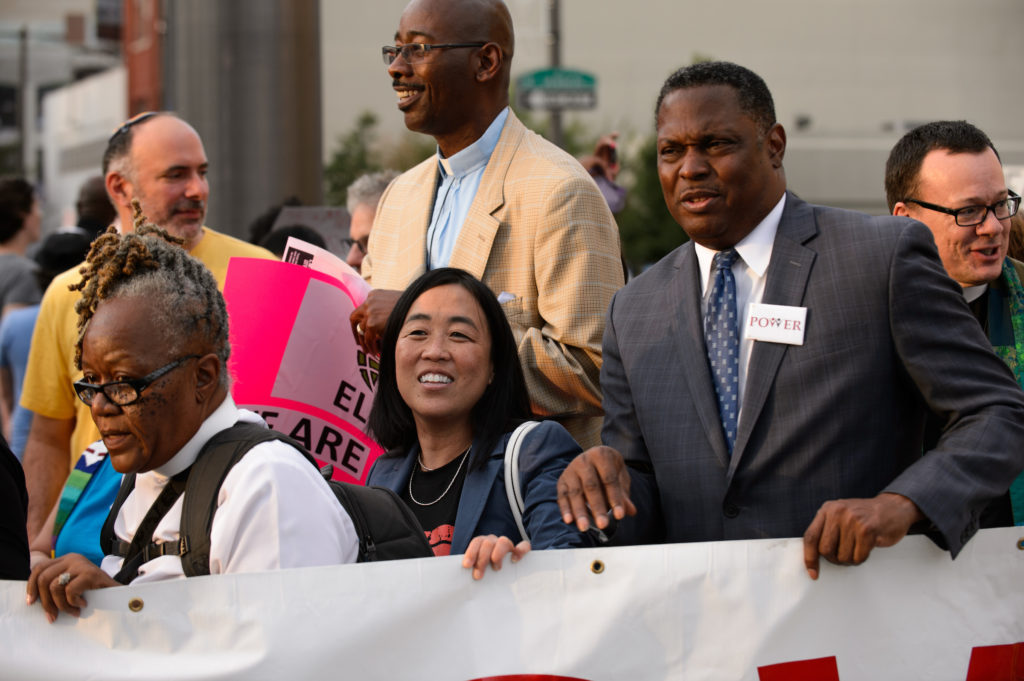 "Councilwoman Helen Gym and Rev. Greg Holston prepare to march down Broad Street as part of the ""Philly Is Charlottesville"" rally on Wednesday, August 16, 2017."