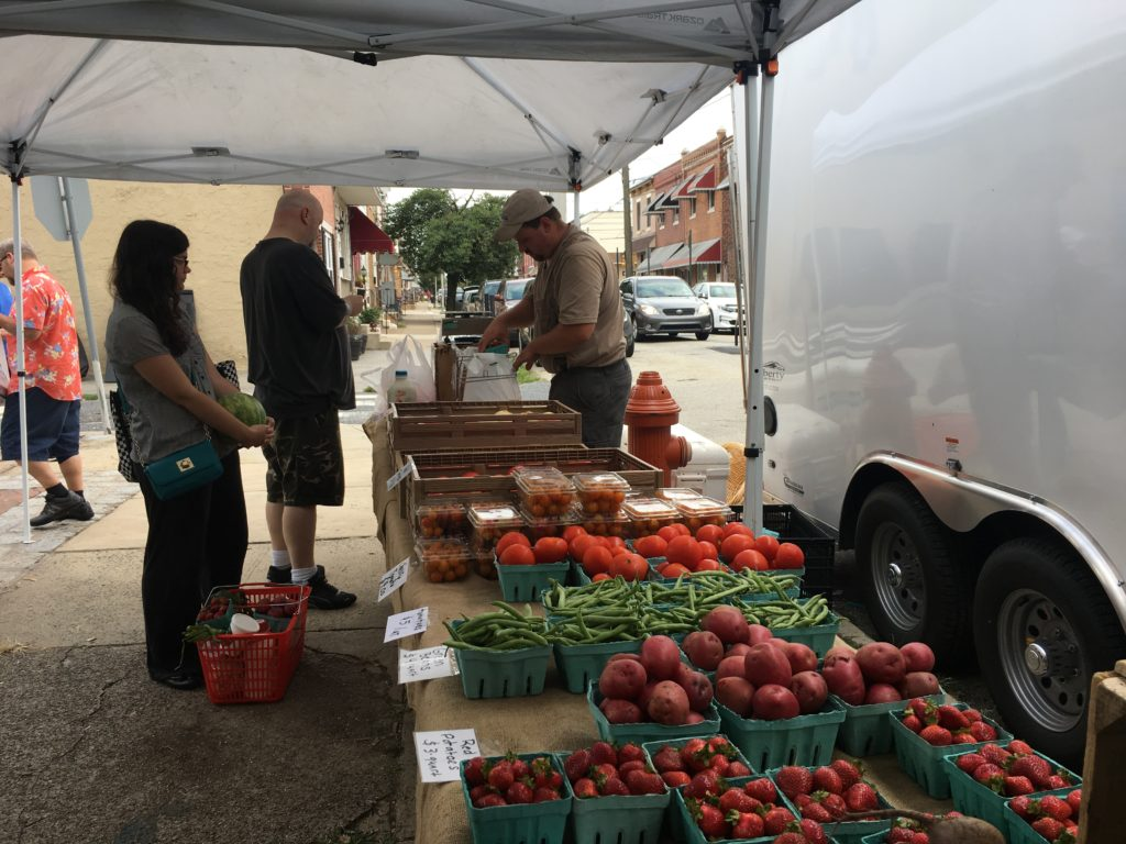 Casey Noss of Goose Lane Egg Farm at the Powers Park farmers market in Port Richmond