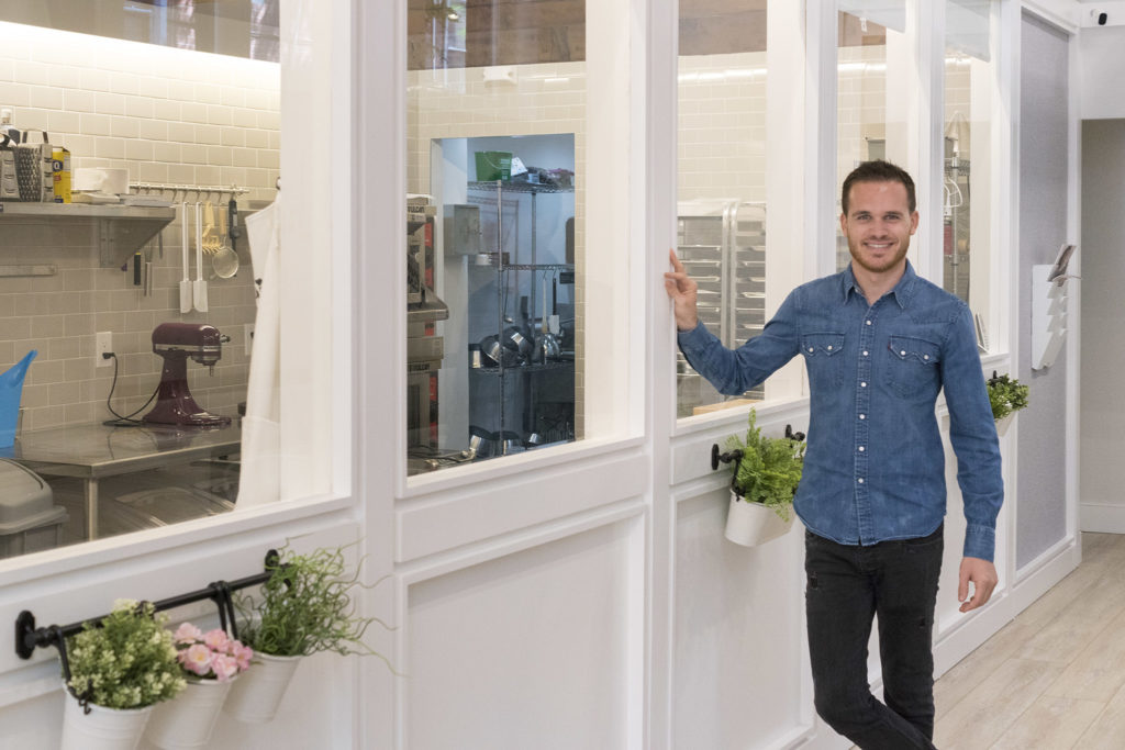 Bastien Ornano in front of his windowed baking kitchen