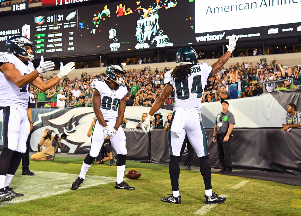 Marcus Johnson (84) celebrates after scoring a touchdown against the Dolphins.