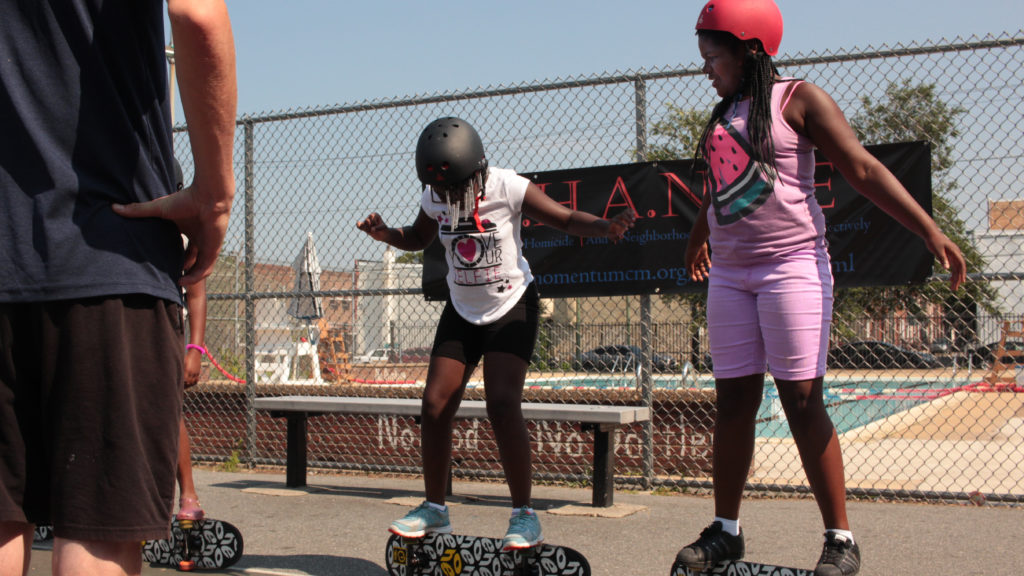 Genesis Stone-Burton, left, and Iadalis Saunders-Boone practice their skateboard skills at Vare Rec Center
