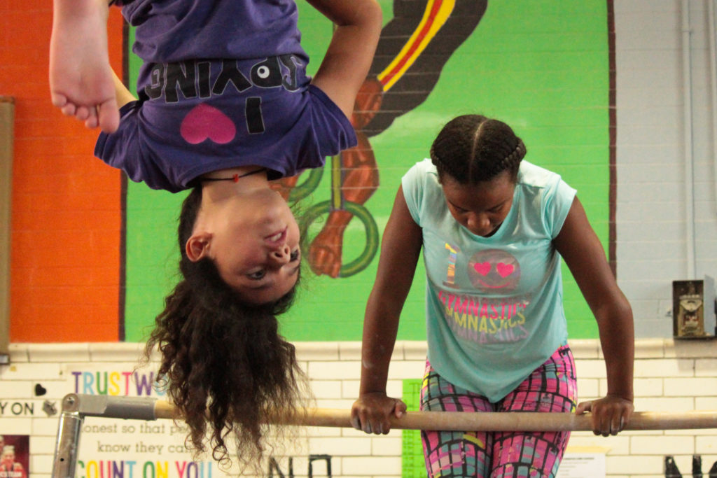 Yahiyah Devaughn, left, and Elianna Olsen practice gymnastics at Vare Rec Center