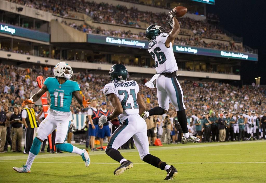 Jaylen Watkins (26) intercepts a pass intended for Miami Dolphins wide receiver DeVante Parker.