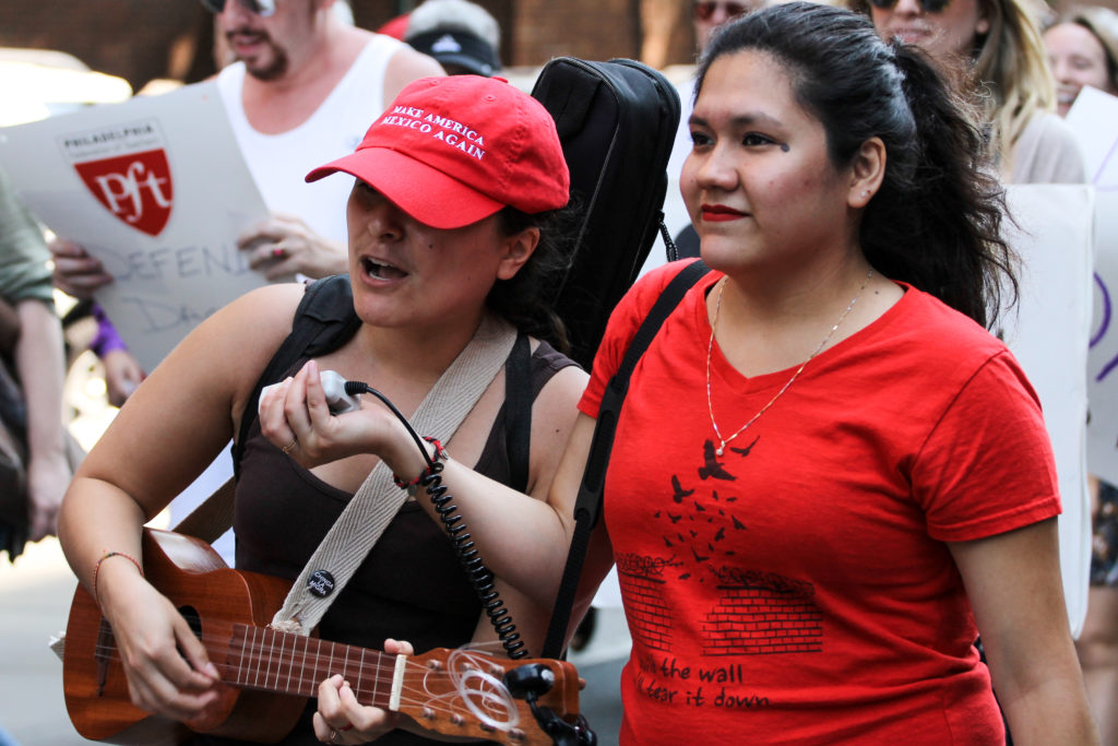 "Maria Castañeda (right), a DACA recipient and student at Swarthmore, holds a microphone for  Yared Portillo (left). During the march, Portillo chanted and played the jarana, an instrument native to the Mexican state of Veracruz. ""I'm here to keep fighting alongside my community. The fight doesn't stop, the fight started well before this,"" Portillo said."