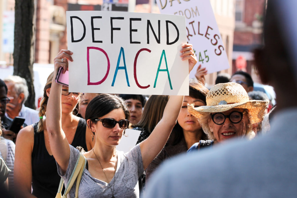 "On Tuesday, protesters gathered at a ""Take Down Sessions, Defend DACA!"" march organized by Juntos, a community Latinx organization."