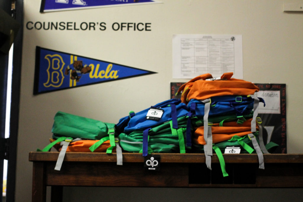 Donated backpacks sit by the counselor's office at Henry Lea Elementary School in West Philadelphia. Guidance counselors will filter the supplies to students in need.
