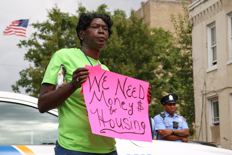 Constance Morrow, a director of the Women's Community Revitalization Project, stands among demonstrators in Sharswood Sept. 19, 2017 protesting HUD cuts.