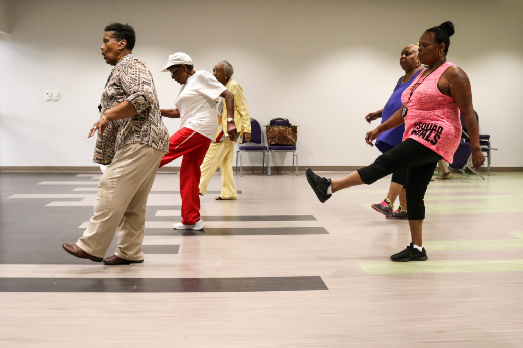 Members of MLK Older Adult Center spin, kick and slide at the center's line dancing class.