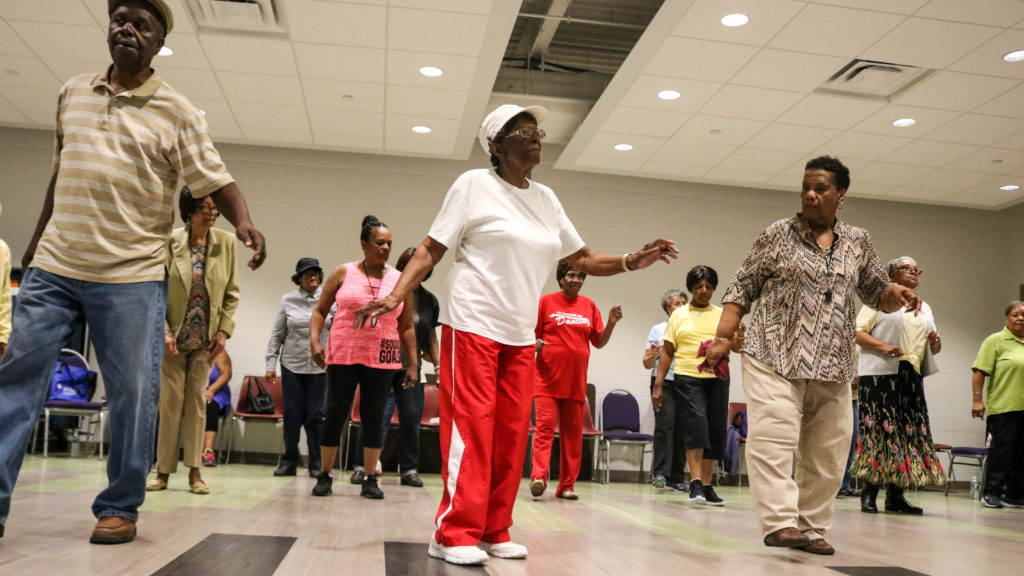 Lillie Jones (center), who has been line dancing for 12 years, steps front and center during Chiquita Smith's (right) class.