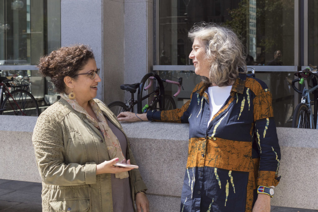 Photographer Wendy Ewald (right) talks with Al-Bustan founder Hazami Sayed