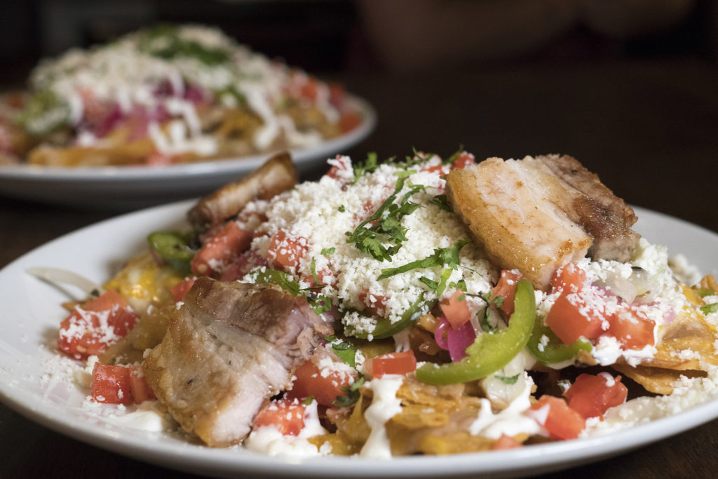 Pork belly nachos are a Pistola's classic
