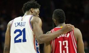Joel Embiid puts his arm around Houston Rockets guard James Harden