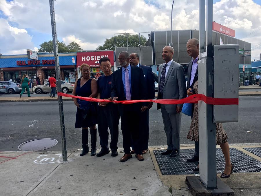 A parking space ribbon-cutting on North Broad Street. Pictured L to R: Community activist Tonya Bah, Olney Steak and Beer owner Choon Yoo, Sen. Art Haywood, his chief of staff Dwight Pedro Lewis, La Salle University Chief of Staff to the President and Director of Government Affairs Joe Meade (LaSalle), Einstein Hospital Constituency Relations Manager Leroy Howell and SEPTA Constituent Relations Coordinator Rochelle Culbreath