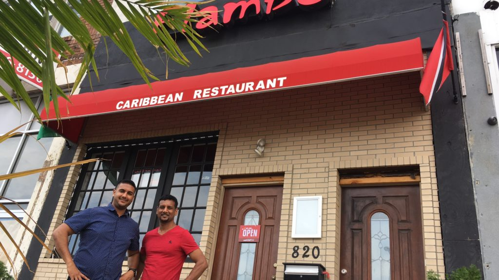 Kevin Ramlochan, left, and his father, Anthony Logan, opened Trinidadian restaurant Flambo last December.