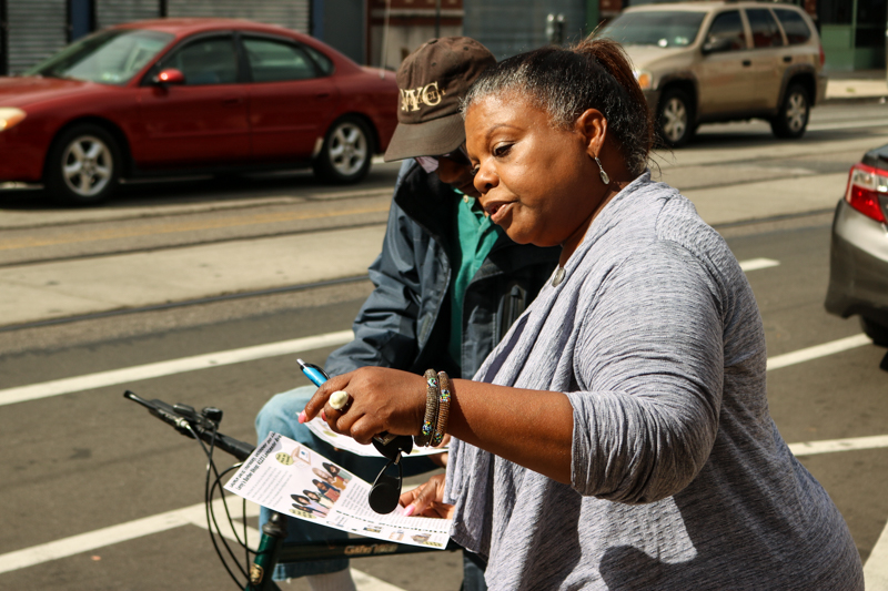 Cass Green, manager manager of community outreach and partnerships at the Philadelphia Emergency Center, speaks with a biker about the initiative.