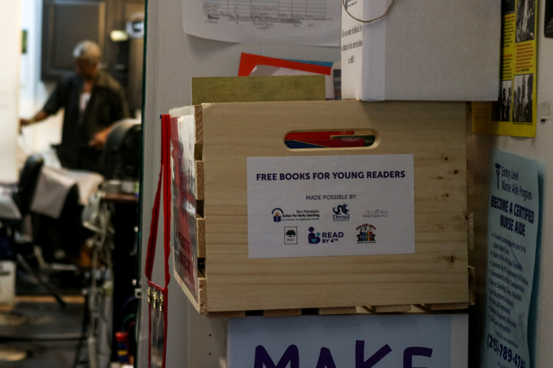 A new crate of donated books sits in Leroy's Barber Shop near 41st and Lancaster Ave.