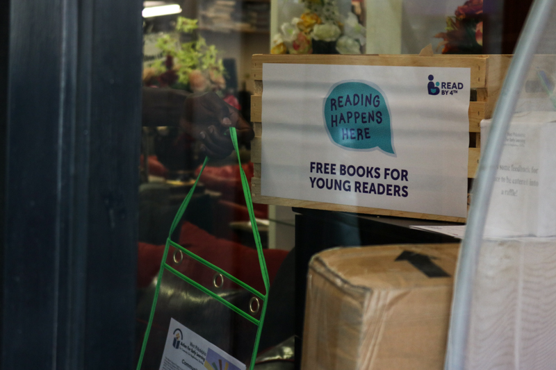 Sadidi Furniture, a participating local business near 41st and Lancaster, displays a crate of books in the front window.