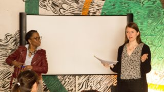 LaQuisha Anthony (left) and Leah Dirkse from WOAR teach bartenders about Safe Bars Philly in 2017