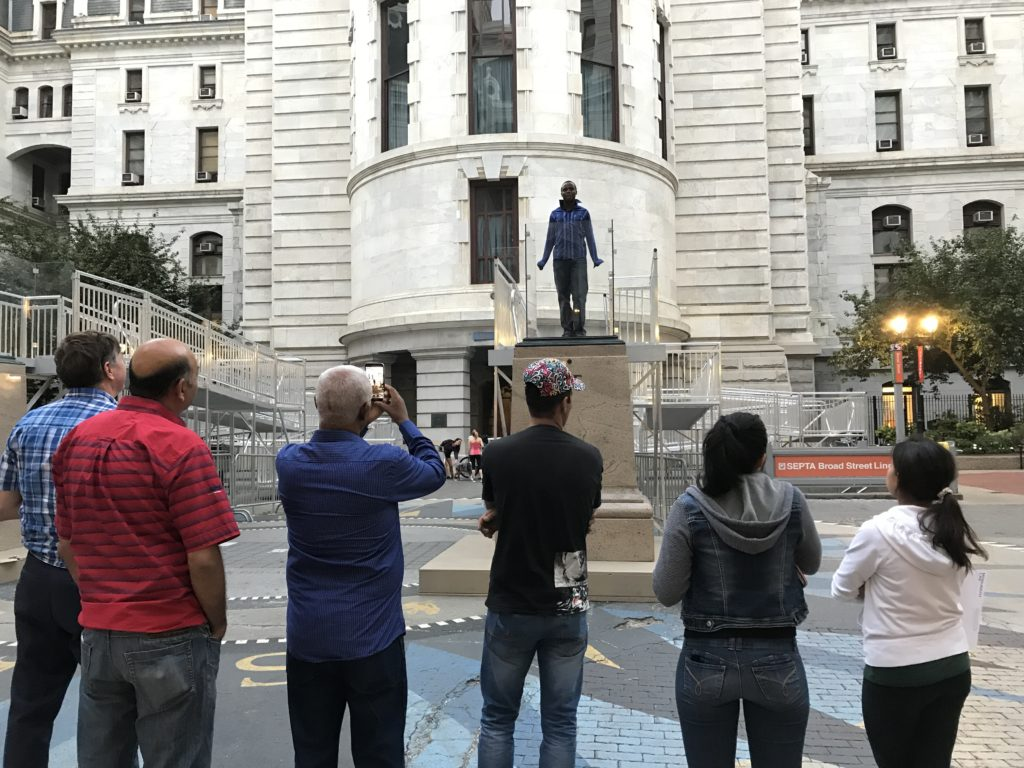 A former student reciting his speech in front of the class at City Hall.