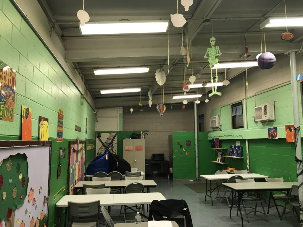 The arts and crafts from the after school program can be seen all around the room.