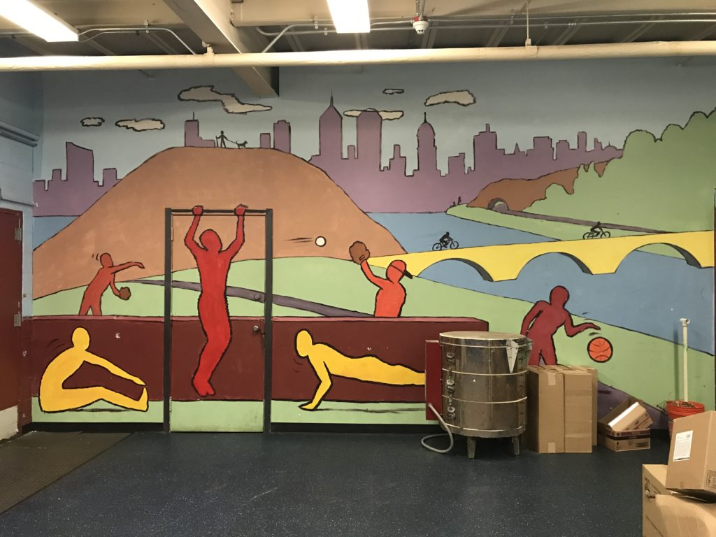 The mural in the new multi-purpose room was painted with the help of Jimmy Rollins and other Phillies players.