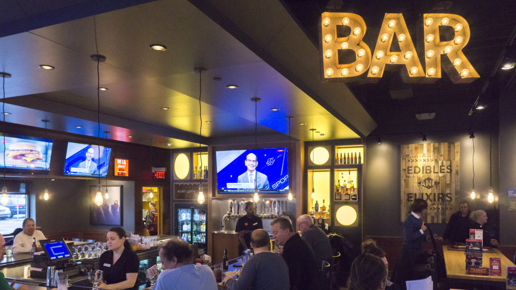 The new look at Applebee's features Edison bulbs and exposed brick