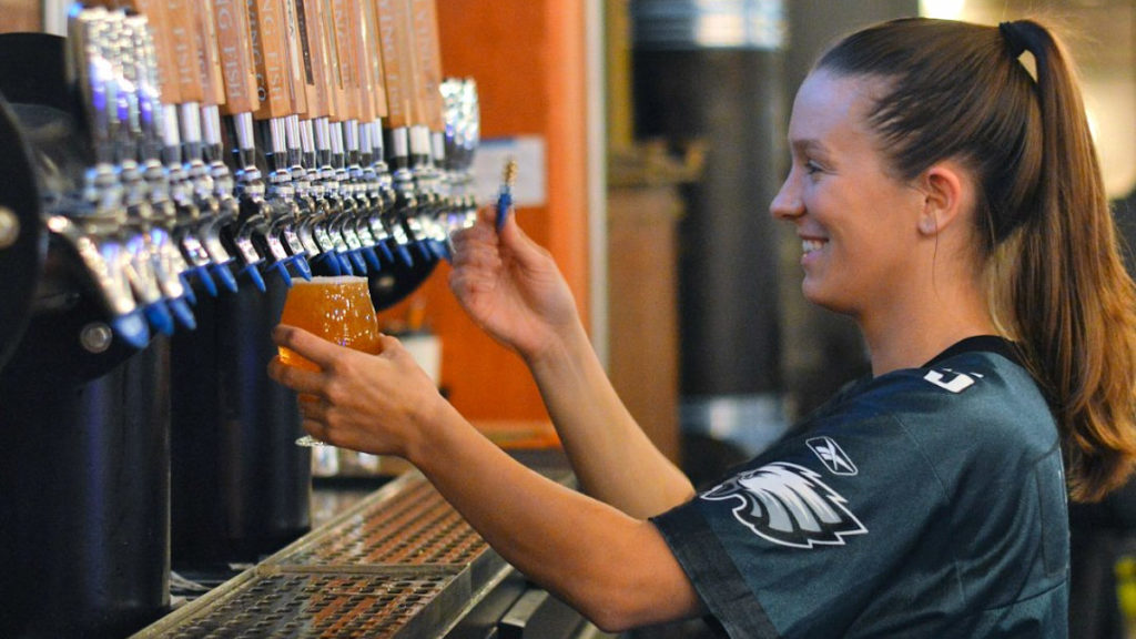 A bartender gets into the spirit at Flying Fish Craft House