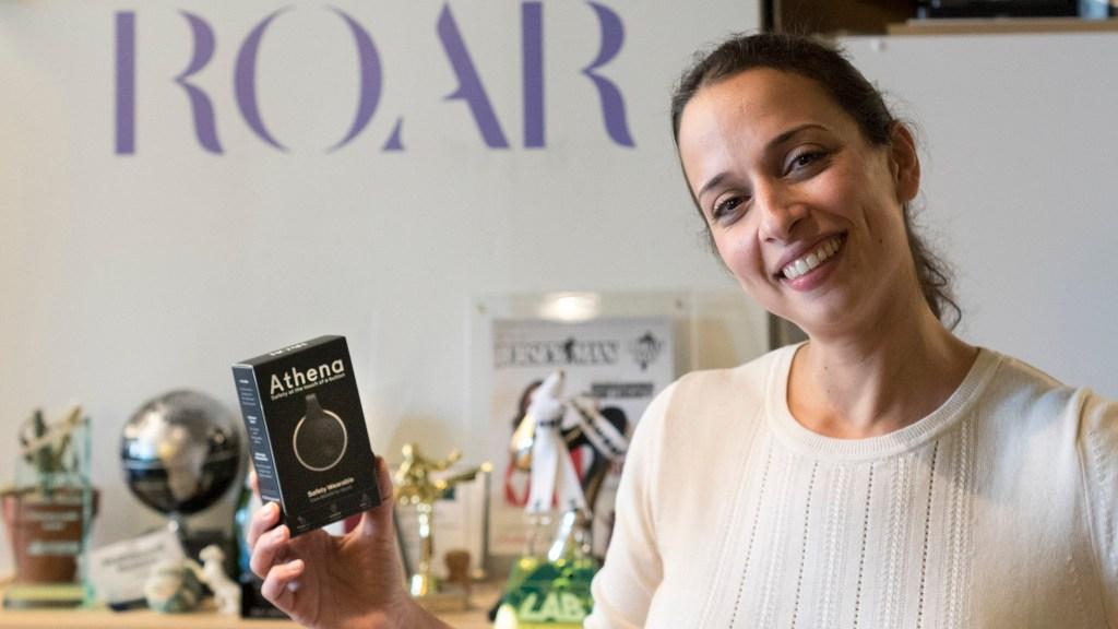 ROAR for Good founder Yasmine Mustafa holds an Athena device