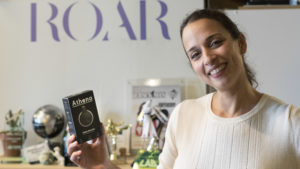 ROAR for Good founder Yasmine Mustafa holds an Athena device