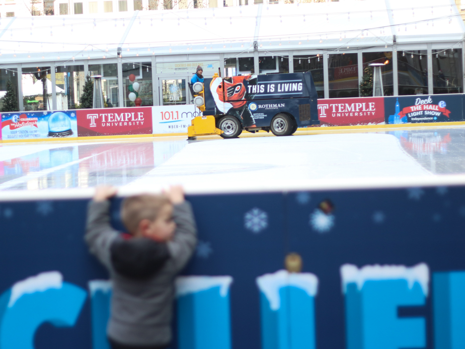 The ice rink getting smoothed up before the crowds come in.