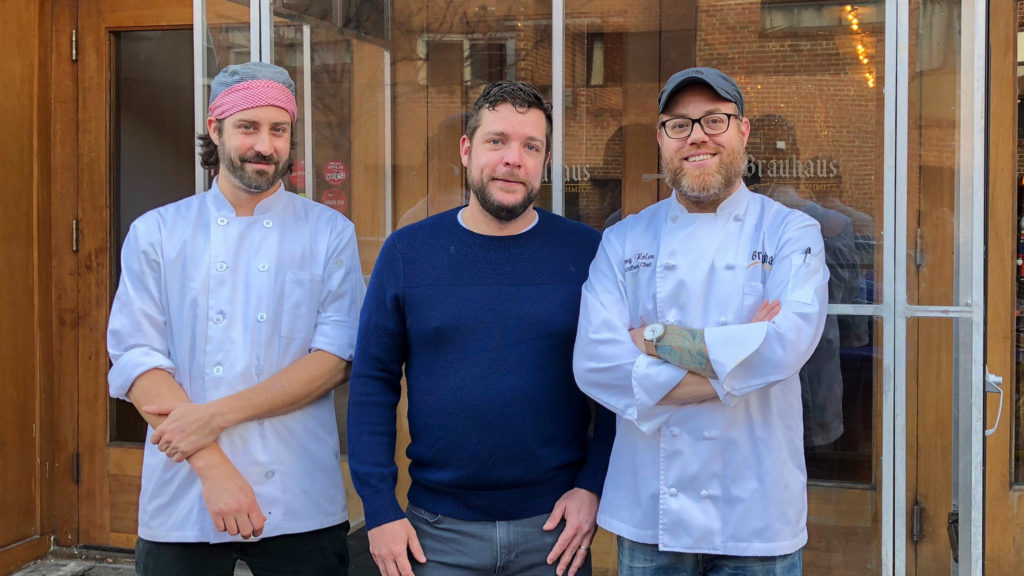 Brauhaus Schmitz proprietor Doug Hager (center), flanked by opening chef Jeremy Nolen (right) and incoming chef Valentin Bay (left)