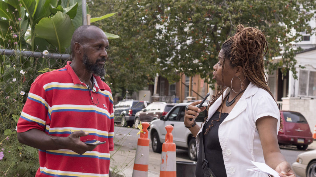 Strawberry Mansion CDC director Tonetta Graham (right) speaks with a resident about neighborhood development