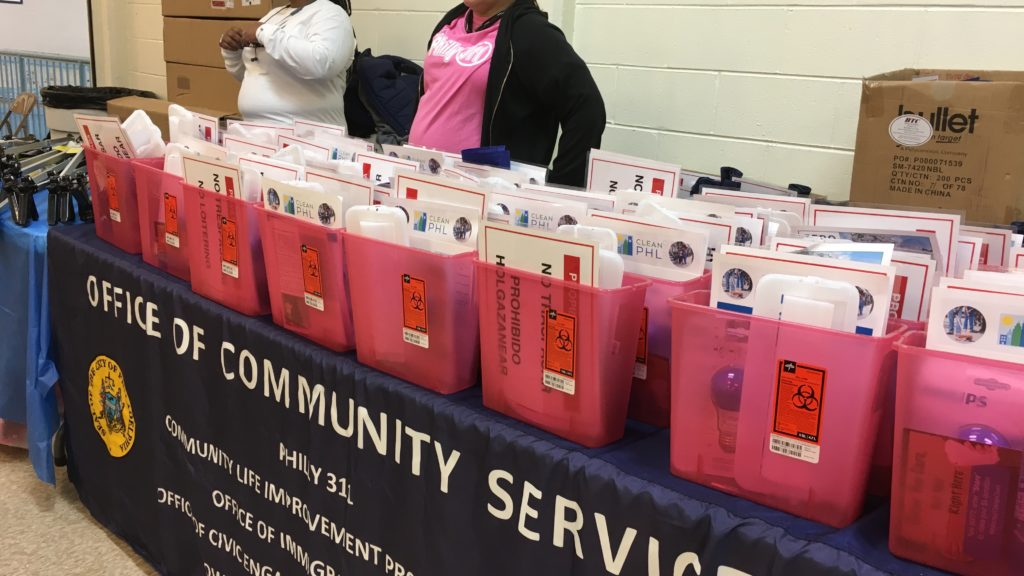 "The city handed out toolkits to people who attended El Barrio Es Nuestro, a community meeting in Fairhill. The kits included blue light bulbs, containers to dispose of used needles and ""no trespassing"" signs."
