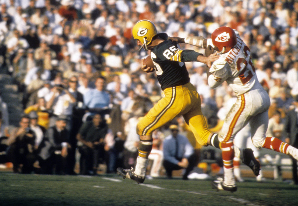 Packers receiver Max McGhee (85) escapes Chiefs defensive back Willie Mitchell (22) during Super Bowl I at the Los Angeles Coliseum in the first ever meeting of the AFL vs NFL World Championship.