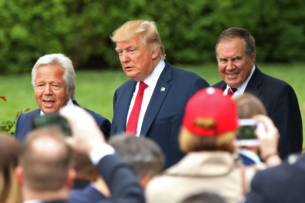 New England Patriots owner Robert Kraft (L) and head coach Bill Belichick (R) with Donald Trump.
