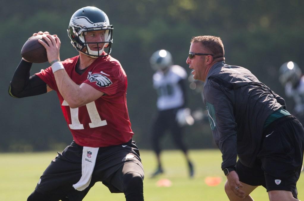 Eagles quarterbacks coach John DeFilippo drills with quarterback Carson Wentz