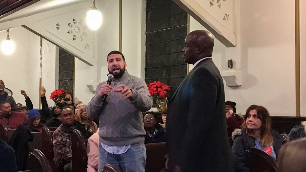Solomon Jones (right), facilitated a town hall meeting on CUES