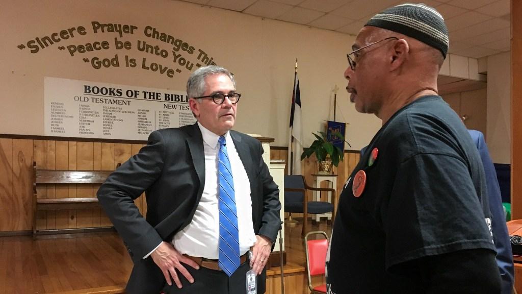 DA Larry Krasner speaks to a West Philly resident