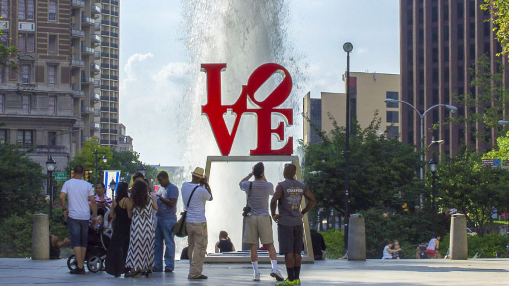 Tourists gather at the LOVE sculpture in 2013