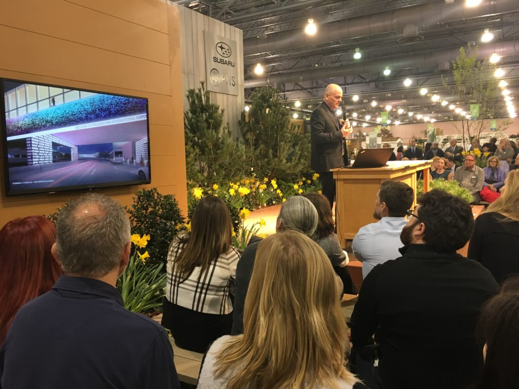 Philadelphia Flower Show attendees hear four teams present their ideas to redesign the airport's exterior.